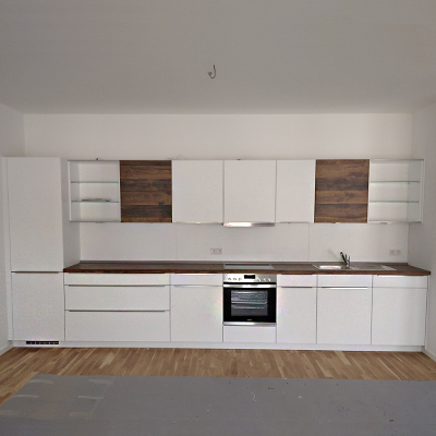 a white kitchen front with dark oak elements